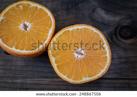 Sliced Orange on a Wooden Table - stock photo
