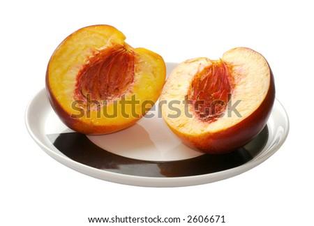 sliced peach on the plate - stock photo