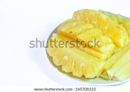 Sliced pineapple on  a dish