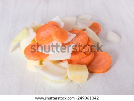 Sliced potato, onions and carrots on grunge white wood background,soup ingredients - stock photo