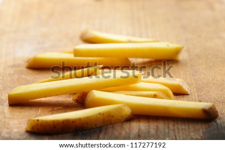 Sliced Potatoes on a Cutting Board. Close up view - stock photo