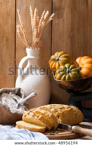 Sliced pumpkin bread in rustic farmhouse setting - stock photo