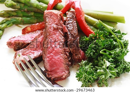 sliced rare beef with asparagus - stock photo