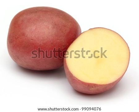 Sliced red potatoes over white background - stock photo