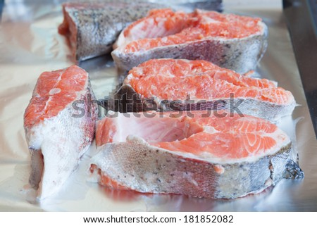 sliced red �¢??�¢??salmon on foil - stock photo