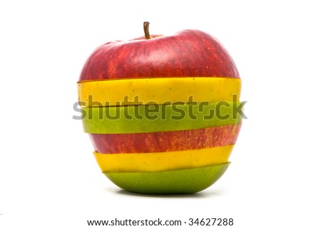 Sliced red, yellow and green apples on studio white
