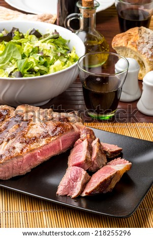 sliced rib cooked rare on the plate - stock photo