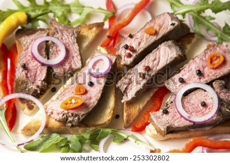 Sliced roast beef with vegetables close up - stock photo