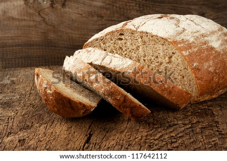 Sliced rye bread on a wooden table - stock photo