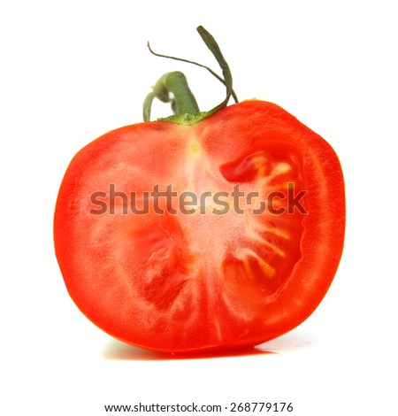 Sliced salad tomato from low perspective isolated on white. - stock photo