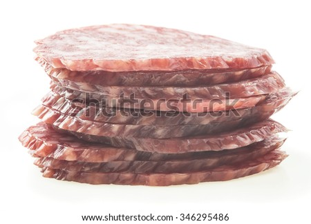 sliced salami isolated on white - stock photo