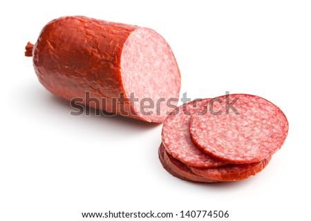 sliced salami on white background - stock photo