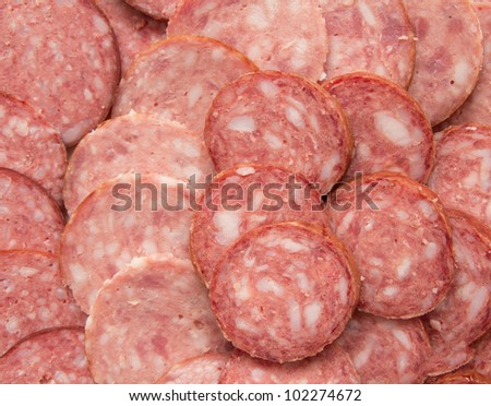sliced ??sausage as background - stock photo
