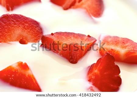 Sliced strawberries in yogurt - stock photo