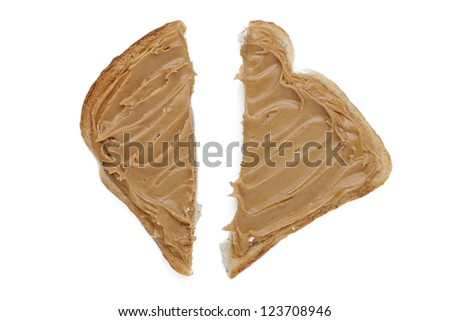 Sliced toast with peanut butter spread lying on white background