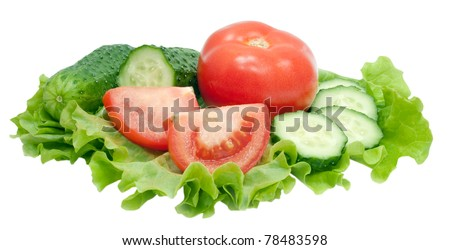 sliced tomato and cucumber with lettuce isolated on white background - stock photo