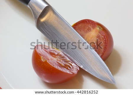 Sliced tomato with a knife