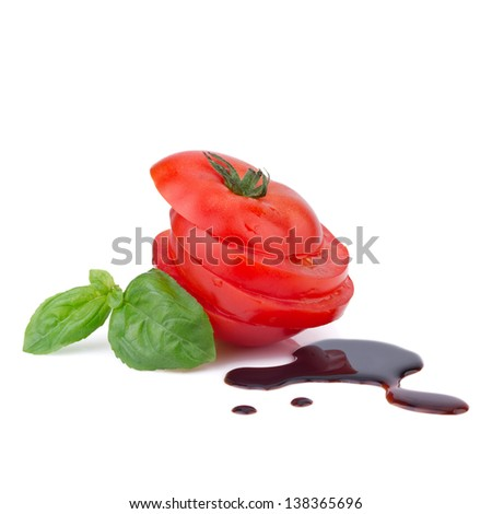 sliced ??tomato with basil and balsamic vinegar - stock photo