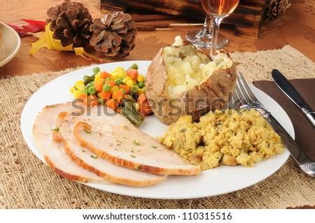 Sliced turkey dinner for Thanksgiving - stock photo