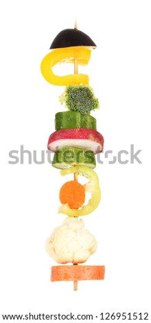 Sliced vegetables on wooden pick holding in hand isolated on white - stock photo