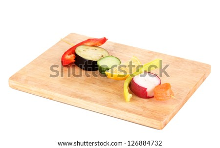 Sliced vegetables on wooden pick isolated on white - stock photo