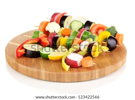 Sliced vegetables on wooden picks isolated on white - stock photo