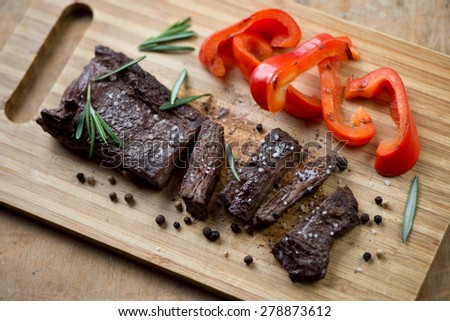 Sliced well-done grilled beef steak machete, high angle view - stock photo