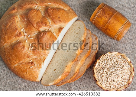 Sliced white bread and seeds of oats. Top view