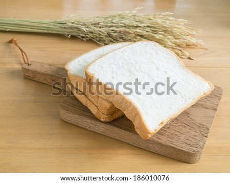Sliced white bread on the chopping board