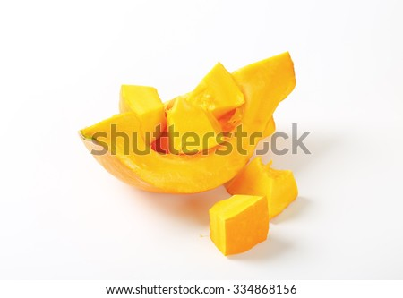 sliced yellow pumpkin on white background - stock photo