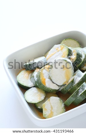 Sliced zucchini and flour with egg wash