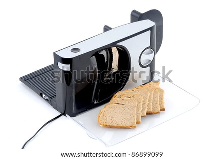 Slicer and bread - stock photo