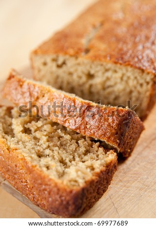 Slices and Loaf of Freshly Baked Organic Banana Bread - stock photo