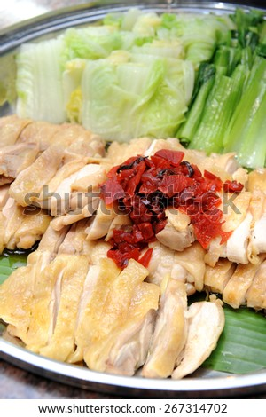 slices  delicious chicken with some vegetable in plate - stock photo