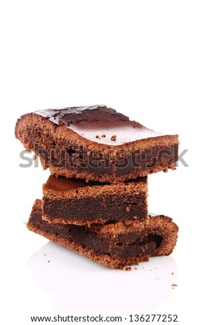 Slices of a brownie on white background