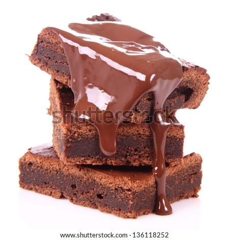 Slices of a brownie on white background covered with chocolate - stock photo