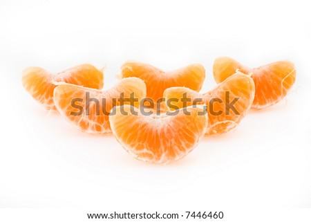 Slices of a ripe tangerine are fancifully placed on a white background