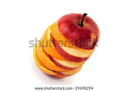 slices of an apple and orange put together to form a hybrid fruit, shot on white in a studio - stock photo