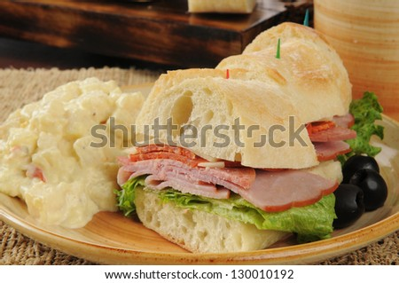 Slices of an Italian submarine sandwich with potato salad