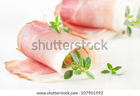 Slices of bacon and herbs - stock photo