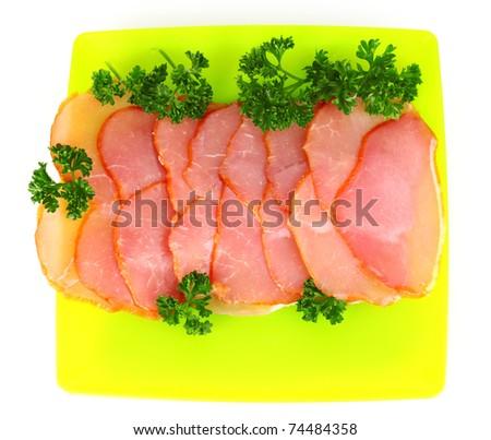 Slices of bacon on white background - stock photo