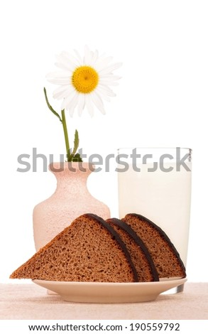 Slices of bread for sandwich on a plate with milk over white background - stock photo