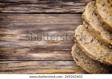 Slices of bread on a wooden background.  - stock photo