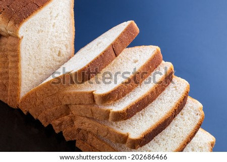 slices of bread on blue background - stock photo