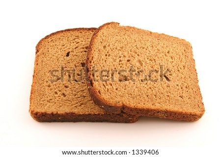 Slices of brown bread isolated on white background