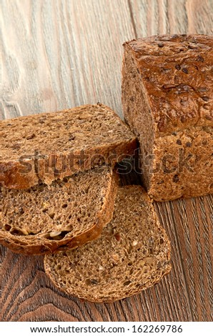 Slices of brown bread on a wooden table