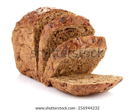 Slices of brown bread on table - stock photo