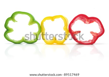 Slices of Capsicums on White Background