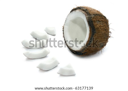 Slices of coconut and half of a coconut isolated - stock photo