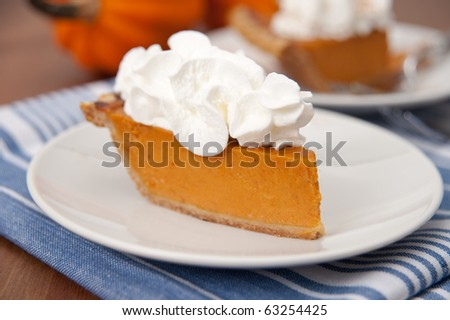 Slices of Delicious Fresh Pumpkin Pie with Wipped Cream